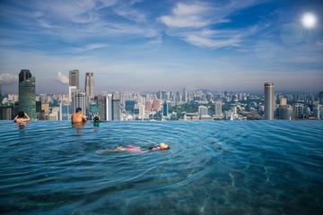 Asian girl swim in swimming pool