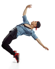 Full length portrait of an excited man dancing isolated on white background