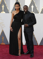 Presenter Kevin Hart arrives with Eniko Parrish at the 88th Academy Awards in Hollywood