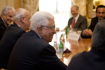 Palestinian President Abbas smiles as he has a last-minute meeting with U.S. Secretary of State Kerry in Riyadh