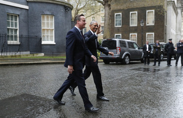 Britain's Prime Minister David Cameron and U.S. President Barack Obama leave Number 10 Downing Street in central London