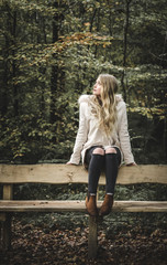 Young blonde woman on bench