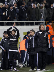 Besiktas' Quaresma greets his supporters beside his team's coach Schuster during their Europa League Group L soccer match against Rapid Wien in Istanbul