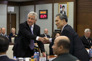 U.S. Secretary of Defense Hagel and South Korean Defense Minister Kim shake hands for a photograph at the 45th Security Consultative Meeting at the Defence Ministry in Seoul