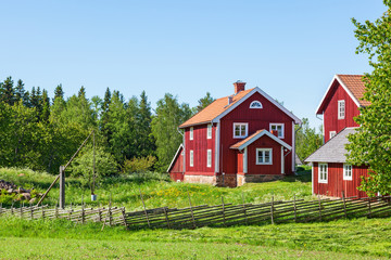 Red farm house in rural environment