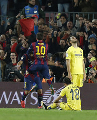 Barcelona's Messi celebrates his goal with teammate \Suarez against Villarreal during their King's Cup semi-finals first leg soccer match at Nou Camp stadium in Barcelona