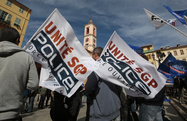 French police stand behind labour union banners as they protest in front of the courthouse in Nice
