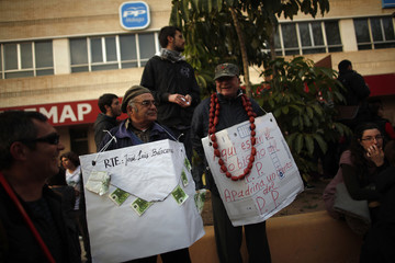"""Pensioners stand during a demonstration demanding """"The right to decent housing, stop evictions, the retroactive payment in kind and social rents"""" in Malaga"""