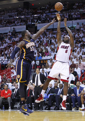 Miami Heat's LeBron James shoots over Indiana Pacers' Roy Hibbert during the third quarter in Game 5 of their NBA Eastern Conference final basketball playoff in Miami
