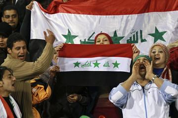 Iraqi fans cheer during their 2014 World Cup qualifying soccer match against Jordan in Amman