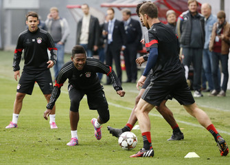 Bayern Munich's players Bernat, Alaba, Dante and Alonso attend a training session on the eve of their Champions League Group E match against CSKA Moscow outside Moscow