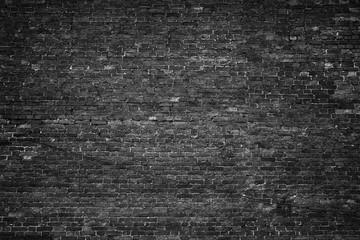 black wall, brick texture, dark background