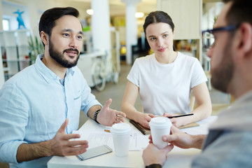 Interview of two employers with one of applicants for vacancy