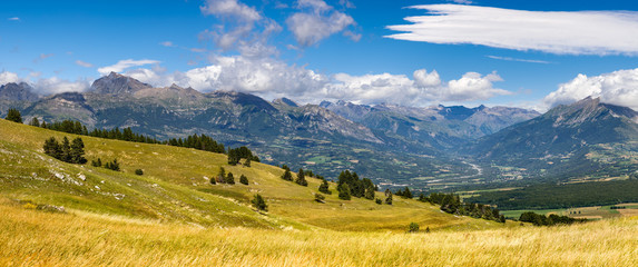 Panoramic view on the Champsaur and the Drac River Valley in summer from Gleize Pass. Hautes-Alpes, Southern French Alps, Paca Region, France