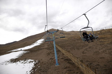 Tourists use the chairlift at the El Colorado ski centre at Los Andes Mountain range, near Santiago