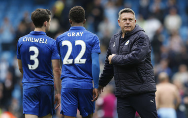Leicester City manager Craig Shakespeare with Demarai Gray and Ben Chilwell after the match