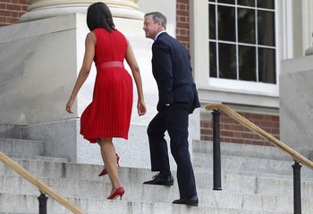 U.S. first lady Michelle Obama walks up the steps of the State House with Maryland Governor O'Malley, in Annapolis