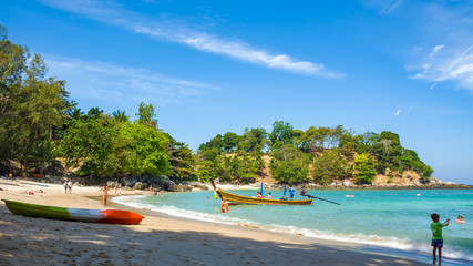 Tourists on Paradise Beach - one of the beaches of Phuket island, Thailand. Picture aspect ratio 16: 9