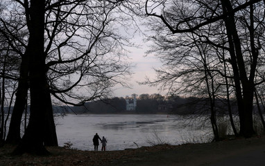 People look at the Pfaueninsel (Peacock Island), an island in the river Havel in Berlin