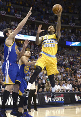 Denver Nuggets' Chandler shoots over Golden State Warriors' Bogut and Curry in the first quarter of their second NBA Western Conference Quarterfinals basketball playoff series in Denver, Colorado