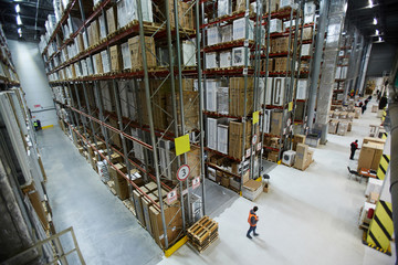 Large factory or warehouse with goods and workers