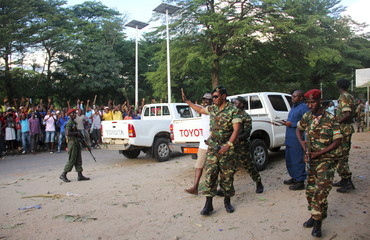 Major General Niyombare waves to civilians as he arrives at the RPA broadcasting studios to address the nation in Burundi's capital Bujumbura