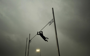 Dark clouds form overhead as Britain's Lewis competes in the men's pole vault event during the London Grand Prix Diamond League athletics tournament at Crystal Palace