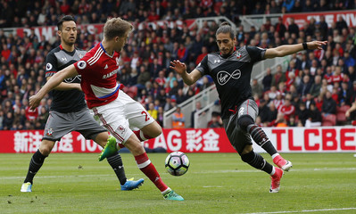 Southampton's Martin Caceres and Maya Yoshida in action with Middlesbrough's Patrick Bamford