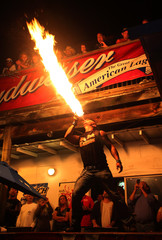 Performance artist Torch blows fire from his mouth at the biker bar Suck Bang Blow in Murrells Inlet, South Carolina