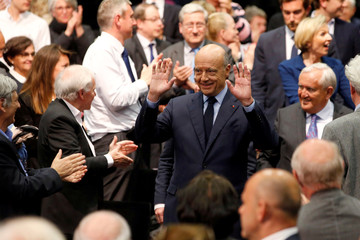 French presidential hopeful Alain Juppe, seeking to win his centre-right Les Republicains party's nomination in primaries in November, arrives at a political rally in Paris