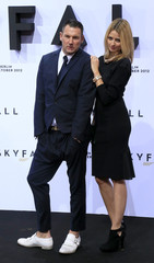 Michalsky and Padberg pose on red carpet for German premiere for latest 007 James Bond film 'Skyfall' in Berlin