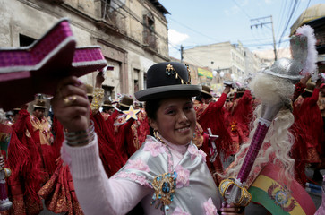 A Morenada dancer performs during the Lord of Great Power parade in La Paz