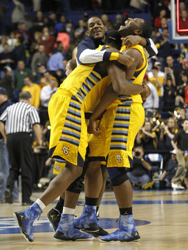 Marquette University's Chris Otule (L) celebrates with Davante Gardner (R) after defeating Butler University during in their third round NCAA basketball game at Rupp Arena in Lexington