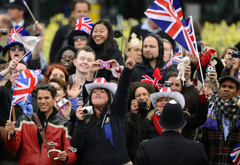 People gather outside Buckingham Palace before the wedding of Britain's Prince William and Kate Middleton in Westminister Abbey, in central London