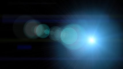 Bright light with lens flare. Blue abstract background with spotlight beam.