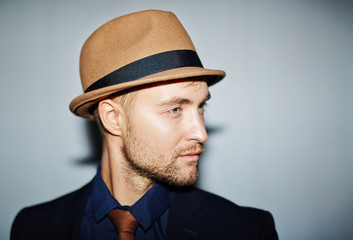Attractive young man in hat and suit