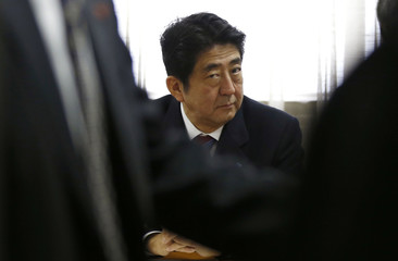 Shinzo Abe, Japan's incoming PM, attends a meeting at the LDP headquarters in Tokyo