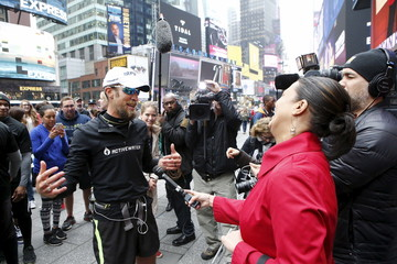 Wendell speaks with the media as he arrives in Times Square, New York after completing 100 marathons in 100 days
