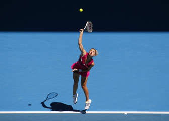 Zahlavova of the Czech Republic serves to Williams of the U.S. during their match at the Australian Open tennis tournament in Melbourne