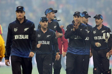 Martin Guptill leads New Zealand off after beating the West Indies in their Cricket World Cup quarterfinal match in Wellington