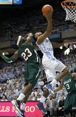 The University of North Carolina's Strickland goes to the basket against the defense of Mississippi Valley State University's Jones and Joyner during their NCAA basketball game in Chapel Hill