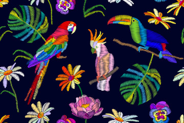 Tropical summer night. Seamless vector pattern with parrots, toucan, flowers and palm leaves on black  background.