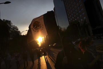 People demonstrate against the government of Mexico's President Nieto, in Mexico City