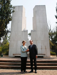 France's president Francois Hollande next to Chilean senator Isabel Allende, daughter of late former Chilean President Salvador Allende, visit his tomb at Santiago's General Cemetery during Hollande's official visit to the country, in Santiago