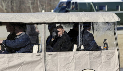 Afghanistan's President Ghani waves from an enclosed cart during his arrival with U.S. Secretary of State Kerry for diplomatic meetings at Camp David, Maryland