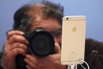 A photographer takes a picture of an iPhone 6 Plus after it went on sale at the Apple store in Sydney