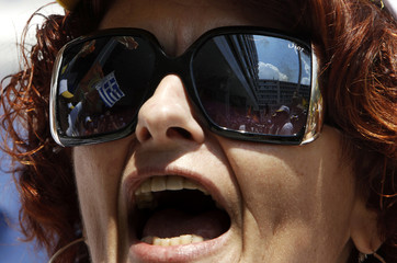 An employee of Hellenic Postbank shout slogans during a rally against privatisation plans in Athens
