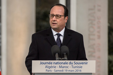 French President Francois Hollande delivers a speech to commemorate the end of the war with Algeria at a ceremony in Paris