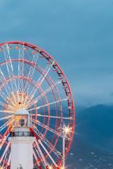 Batumi Georgia. Close View Of Ferris Wheel And Top Of White Ligh