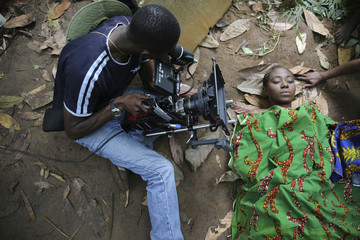 "A cameraman films a scene for the movie ""October 1"", a police thriller directed by Kunle Afolayan, at a rural location in Ilaramokin village, southwest Nigeria"
